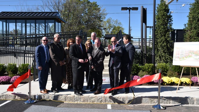 Mayor John E. McCormac, the Woodbridge Township Redevelopment Agency, representatives from Atlantic Realty Development Corporation and New Jersey Transit celebrated the grand opening of Station Village at Avenel and the newly renovated NJ Transit Commuter Train Station in the Avenel section of the township Tuesday.