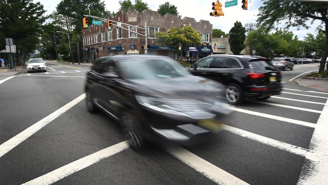Cars move through the intersection of Fort Lee Road and Broad Avenue in Leonia in July.