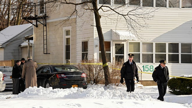 Troy police investigate multiple deaths on Dec. 26, 2017, in Troy, N.Y. Police say four people have been found dead and may have been killed in an apartment in New York's capital region.