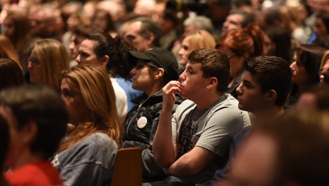 Participants listen during a rally for gun legislation at Temple B'nai Abraham in Livingston on Sunday, Feb. 25, 2018.