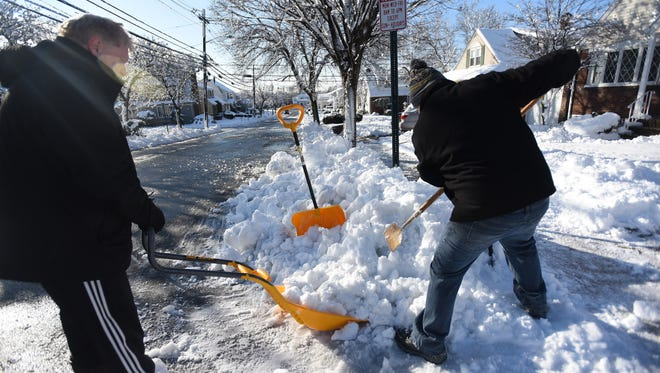 Fair Lawn Residents Dan Reznik (L) and Mark Nulman (R) removes snow in front of their home in Fair Lawn on 03/08/18.