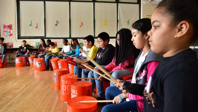 A drumming class. Students from several New Jersey immersive ensemble music learning programs converge in Paterson for the 4th annual Fiddlefest and Falala Festival in Paterson.