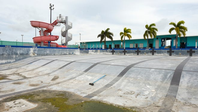 The northern public swimming pool in Dededo remains drained as it undergoes renovation on March 27, 2018. Department of Parks and Recreation Director Bill Reyes said Tuesday that the pool was closed for renovations and not because of the government's financial crisis. Reyes did not know when the renovation will be completed and the pool will reopen. The pool was shut down late September last year for maintenance and repairs. At that time, the Calvo administration had said the pool needed repairs to mechanical equipment, checks for leaks and regular maintenance.