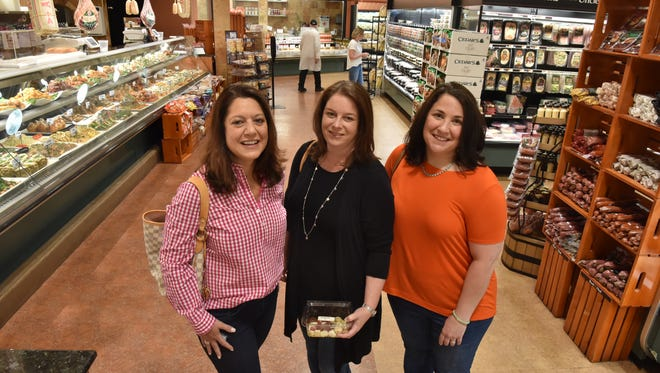 Christine Kearney, Christina Tillsley and Rita Cookson, check out the prepared foods at Uncle Giuseppe's Market Place in Ramsey on Thursday, May 10.