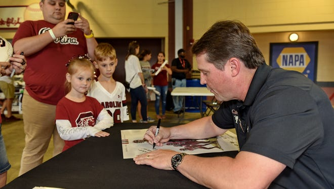 South Carolina head football coach Will Muschamp signs autographs for the Duncan family.The Spurs Up Tour, featuring South Carolina coaches Will Muschamp and Frank Martin, landed at Fluor Field Wednesday, May 16,, 2018 .