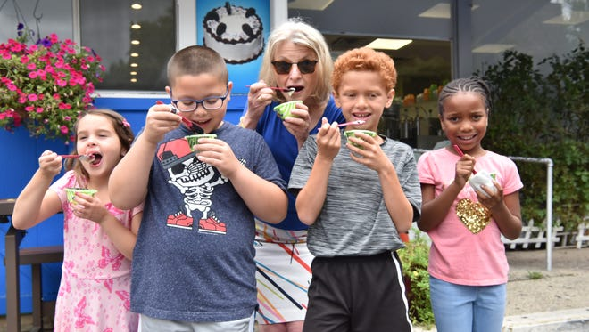 Donatella Senatore, 6, of Hasbrouk Heights, Justin Montero, 8, Towaco, Cameron Weidhorn, 8, Fair Lawn, Ariana Muhammad, 7, Orange and Esther Davidowitz of NorthJersey.com, taste ice cream flavors at Ice Cream on Grand in Englewood, NJ.
