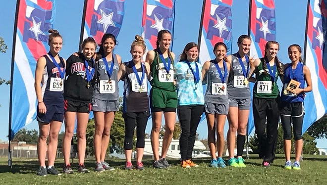 Cornerstone Christian School's Jessica Simon, second from right, and Hannah Slate, sixth from right, finished in the top 10 in Class 1A girls at the TAPPS State Cross Country Championships Monday, Oct. 30, in Waco.