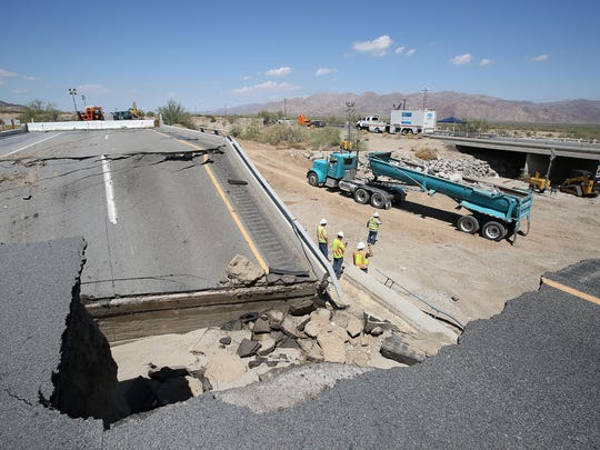 Workers begin the process of shoring up the eroded eastern bank of the Tex Wash, which caused the failure of the Tex Wash bridge on the Interstate 10 which shut down the freeway between Coachella and Blythe.