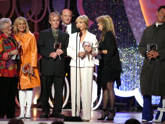 "FILE - In this Saturday, April 14, 2007 file photo, Florence Henderson, center, speaks, as she and, from left, Ann B. Davis, Maureen McCormick, Mike Lookinland, Lloyd Schwartz, Susan Olsen and Barry Williams of the television show ""The Brandy Bunch"" accept the Pop Culture Award during the 5th Annual TV Land Awards in Santa Monica, Calif. Henderson, who went from Broadway star to become one of America's most beloved television moms, died on Nov. 24, 2016. She was 82. (AP Photo/Gus Ruelas)"