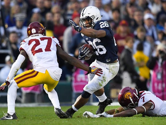 Penn State running back Saquon Barkley runs for a touchdown