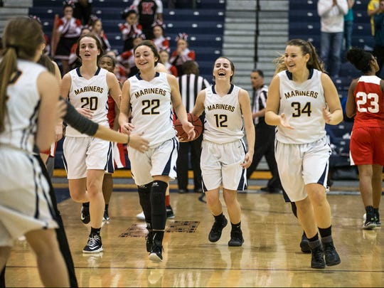 Toms River North celebrates the win. NJSIAA South Group IV semifinal basketball game featuring Toms River North and Kingsway. Toms River, NJFriday, March 3, 2017.@dhoodhood