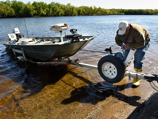 Kevin Luhmann, Monticello, trailers his boat after spending the morning fishing on the Mississippi River Sunday, May 15, near the boat access at Mississippi River County Park.