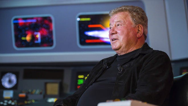 "William Shatner, who portrayed Captain James T. Kirk in the original ""Star Trek"" TV series, answers questions on a replica of the bridge of the Starship Enterprise at Star Trek Original Set Tours in Ticonderoga N.Y. on May 4. Shatner will host a special Q&A event Sept. 23 at the Akron Civic Theater."