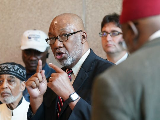 The Rev. Lawrence Livingston, with Mother African Union Church, speaks at a press conference recognizing the 50th anniversary of the assassination of Martin Luther King Jr. and the 50th anniversary of the military occupation of Wilmington.