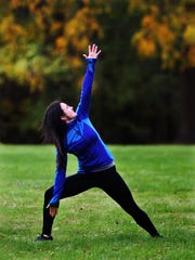 Yoga instructor Jessica Kieser demonstrates the extended