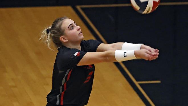Lubbock-Cooper's Kate Siegel (3) sets the ball during a nondistrict match Tuesday against Canyon Randall in Woodrow, Texas.