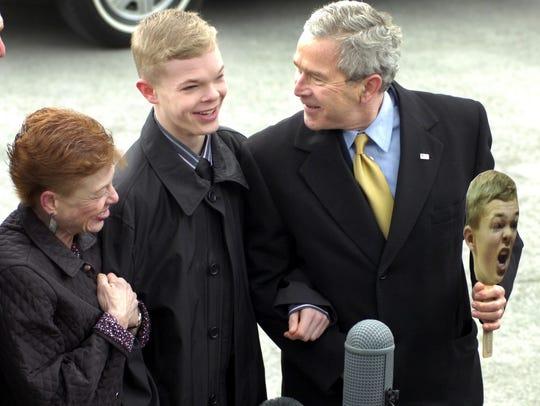 "President George Bush talks with Jason ""J-Mac"" McElwain"