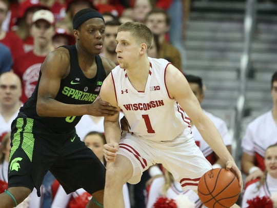 Badgers guard Brevin Pritzl drives on Michigan State's Cassius Winston.