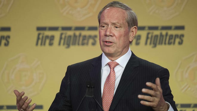 Former New York governor George Pataki speaks at the International Association of Fire Fighters conference in Washington on March 10, 2015.