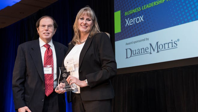 Phil Garber, Partner, Duane Morris LLP presents Corinne Pizzutillo, Senior Recruiter, Xerox Business Services, with the JEVS Human Services' Strictly Business Business Leadership Award, given October 8th at the 17th Annual Strictly Business Awards in Philadelphia.