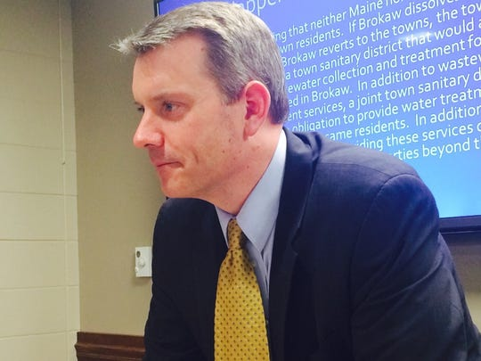 Andrew Phillips with Phillips Borowski, SC helped investigate the village of Brokaw for a Financial and Economic Study with recommendations. Phillips presented the report to local officials with another consultant in the Marathon County Courthouse on Jan. 13, 2015.