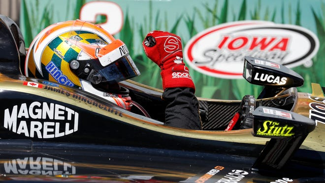 James Hinchcliffe celebrates after winning an IndyCar Series auto race Sunday, July 8, 2018, at Iowa Speedway in Newton, Iowa. (AP Photo/Charlie Neibergall)