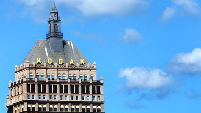 The top of the Kodak building on a sunny day in Rochester.