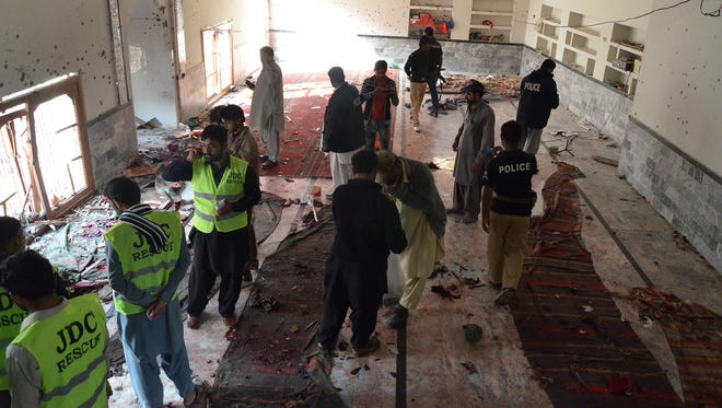 Pakistani security officials gather at a Shiite Muslim mosque after a bomb explosion in Shikarpur in Sindh province on Jan. 30.