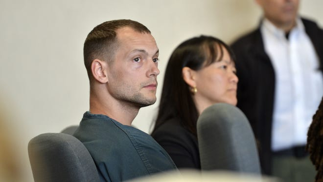 Lucas Gingras, 30, of Milton, left, appears in Vermont Superior Court in Burlington on Tuesday alongside his lawyer Sandra Lee for a change of plea hearing.