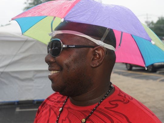 Trumanine Curtis wears his rain hat for the light rains