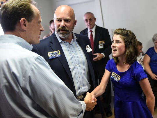 Sen. Pat Toomey meets Lindy Joy Brouillette, 11, and her father, Matt, of North Londonderry Township, as Toomey visited the Lebanon County Republican Party Headquarters on Wednesday, July 20, 2016.