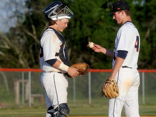 Blackman's catcher Peyton Milam (20) talks with pitcher DJ Wright (4) during the against Walker Valley, on Friday, May 19, 2017.