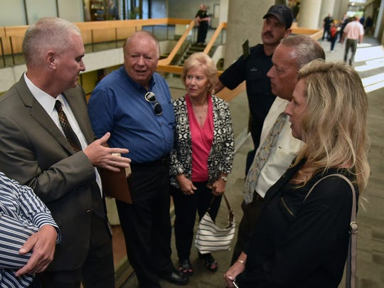 Knox County Assistant Attorney General Leland, left talks with the Newsom and Christian Families after a status hearing Accused killer Eric Boyd Wednesday, June 6, 2018, in Knox County Criminal Court.