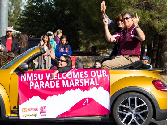 Parade Marshal Jack Nixon shows his Aggie Pride with the guns up salute at the NMSU Homecoming Parade on October 28, 2017.