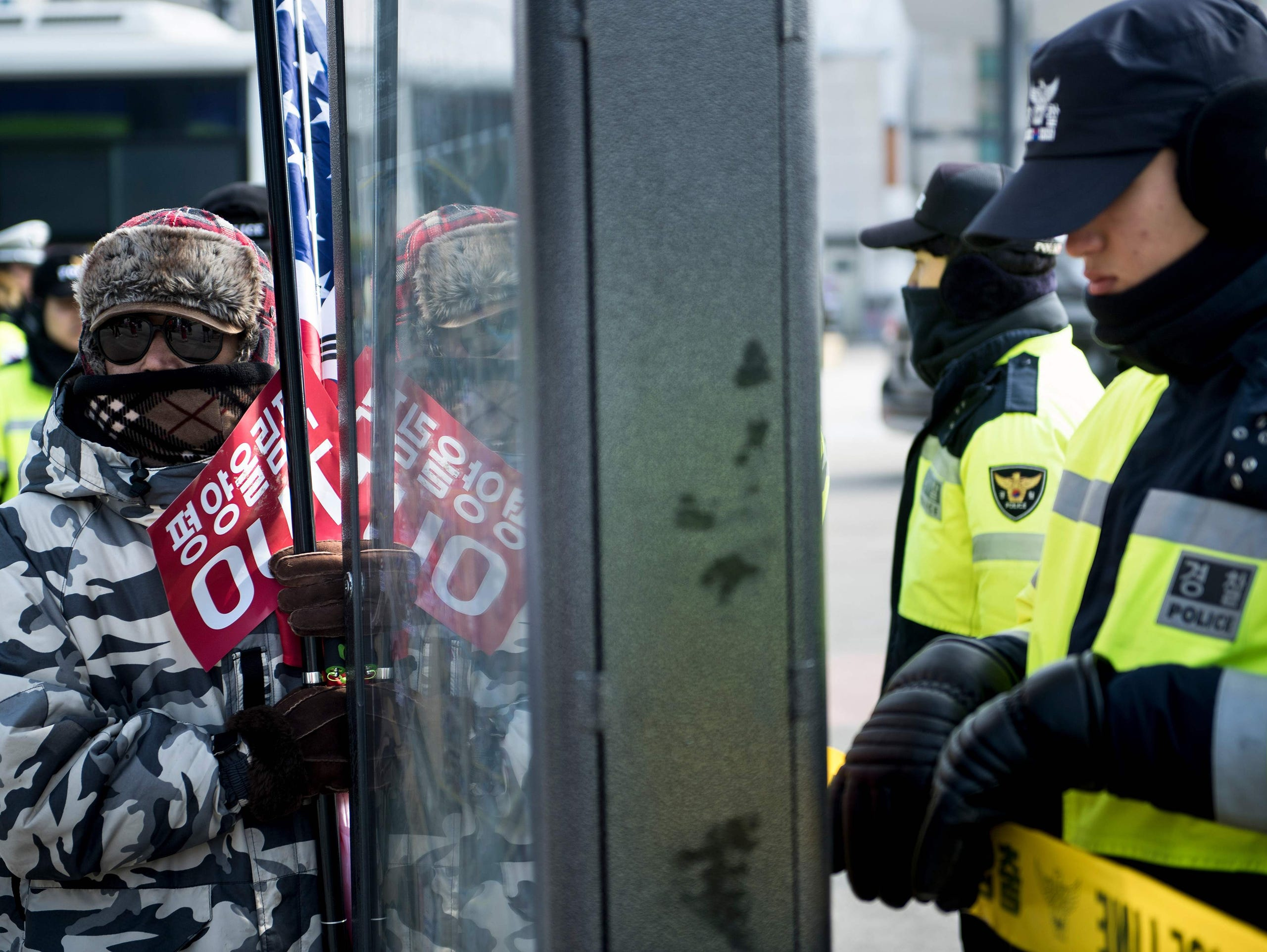 Protesters gathered outside the Olympic Stadium on Friday, before the opening ceremony.