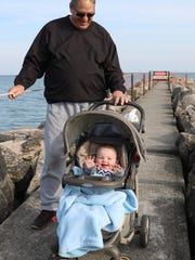 Lue Engler, of Port Clinton, takes his grandson, Roman Miller, out to see the pier for the first time.