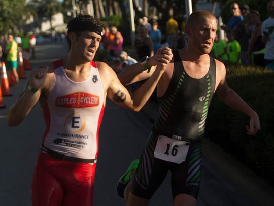 Josh Eaton, left,  and Ross Lenehan race hand in hand