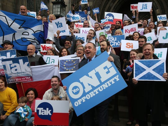 "Scottish First Minister Alex Salmond (front center) meets with Scots and other European citizens to celebrate European citizenship and ""Scotland's continued EU membership with a Yes vote"" at  Parliament Square in Edinburgh, Scotland on Tuesday, Sept. 9, 2014. Opinion polls showing that the independence referendum in Scotland is too close to call have prompted widespread selling of the British pound. If the actual vote on Sept. 18 delivers a knockout blow to Scotland?s 307-year union with England, that selling could become even more pronounced as the United Kingdom is likely plunged into the biggest constitutional crisis in its history."
