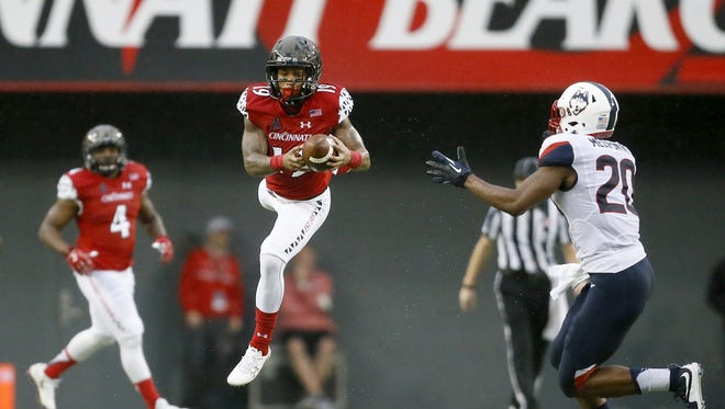 UC wide receiver Shaq Washington makes a catch over the middle during an October 24 game against UConn.