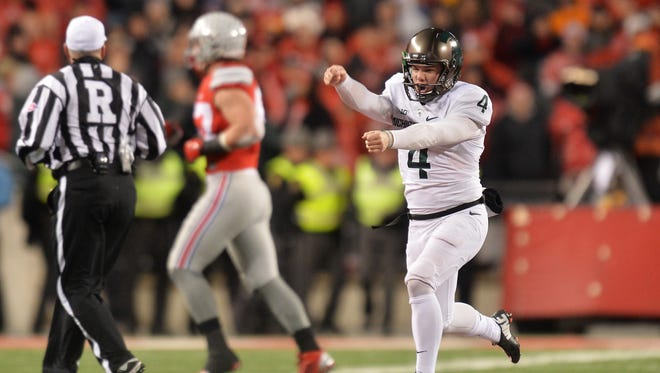 Michael Geiger of the Michigan State Spartans runs up the field after kicking a 41-yard field goal as time expired against the Ohio State Buckeyes on Nov. 21, 2015, in Columbus, Ohio.