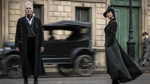 The dark wizard Gellert Grindelwald (left, Johnny Depp)