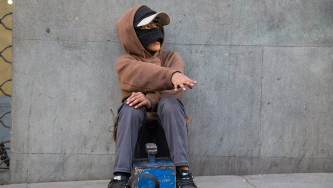 """Isaac Quispe, 11, searches for clients in downtown La Paz. """"A shine, young man?"""" he asks. """"I'll work hard for you."""""""