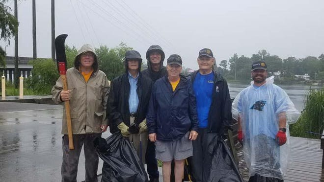 Onslow Rotary Club members recently spent the morning picking up trash along the two bridges at Jacksonville Landing on New River.