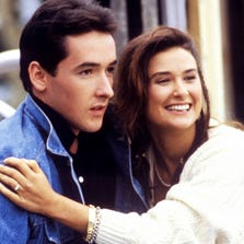 "John Cusack and Demi Moore in a scene from the 1986 film ""One Crazy Summer."""