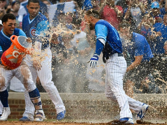 Cubs rookie David Bote gets doused after hitting a walk-off home run to beat the Reds on Aug. 24.