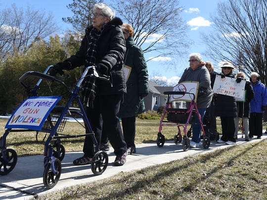Residents of the Brightview senior center in Paramus, NJ participate in the March for Our Lives Rally by carrying signs along Forest Avenue on Saturday March 24, 2018.