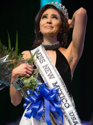 Miss New Mexico USA 2018 Kristen Leyva, left, reacts after winning the  pageant held at Oñate High School on Sunday, January 28, 2018.