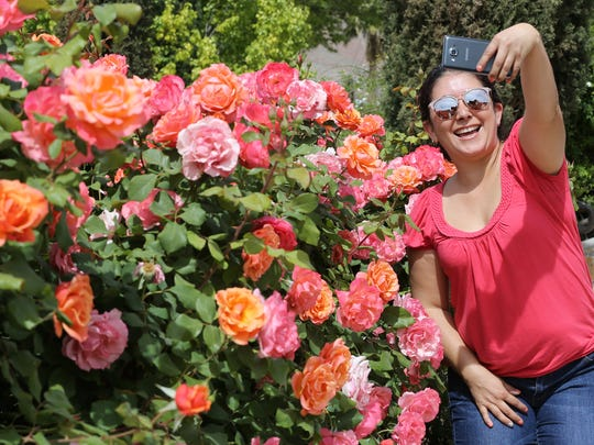 Berta Aldana takes a selfie at the Municipal Rose Garden.