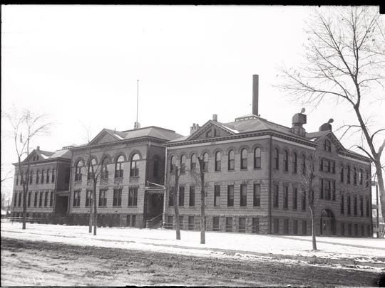 Fort Collins Junior High School, shown in this undated photograph, was constructed in 1903 and served as the first Fort Collins High School before being turned into a middle school and, eventually, Lincoln Junior High School. It was razed in 1975 to make way for the Lincoln Center.