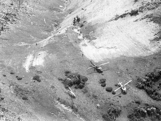 A North Central Mercy Flight helicopter was strewn in Hannan Gulch north of Gibson Dam. Three search helicopters also were pictured, captured from an airplane above the scene.